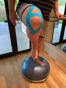 Knee stability K-tape on bosu